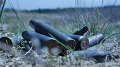 The empty machine gun shells in the grass Stock Footage