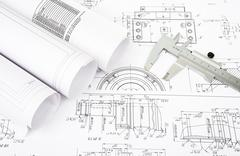 Architecture plan and rolls of blueprints - stock photo