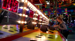 People playing whack gameat the West Coast Amusements Carnival - stock footage