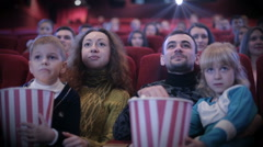 People watching movie at cinema and laughing Stock Footage
