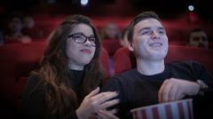 Romantic Couple waching a movie at cinema - stock footage