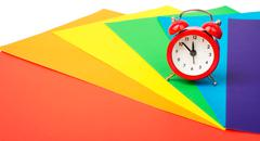 Alarm clock with colorful paper Stock Photos