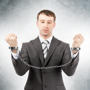 Businessman in cuffs - stock photo
