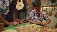 8-Senior Man Lute Maker Teaching Boy Chiseling Wood Stock Footage