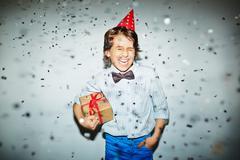 Joyful boy with gift Stock Photos