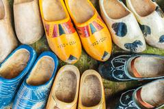 Colorful vintage Dutch wooden clogs - stock photo