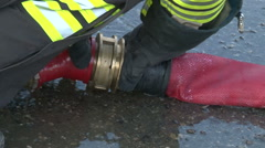 A firefighter prepares the hydrant Stock Footage