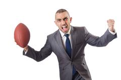 Man with american football ball isolated on white Kuvituskuvat
