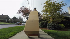 Senior delivery man delivering boxes to residence Stock Footage