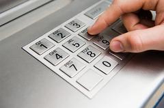 Person pressing cash machine keypad Stock Photos