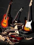 Guitars and smashed guitars Stock Photos