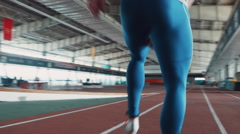 Sprinter leaving start on stadium Stock Footage