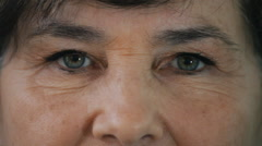 Close up eyes of an old woman Stock Footage