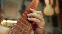 12-Old Man Lute Maker Playing Classic Guitar In Shop Stock Footage