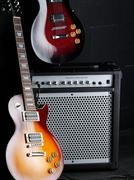 Electric guitars and amplifier Stock Photos