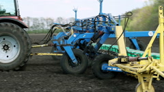 Sowing of sunflower by using contemporary agricultural machinery - stock footage