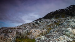 Timelapse clouds passing over rocky boulder field of mountains - stock footage