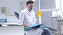 The dentist checks the mouth using tools. Point of view of patient in chair. Stock Footage