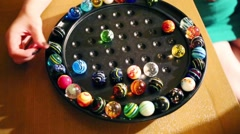 Colorful rubber balls on stand for game on table and hands Stock Footage