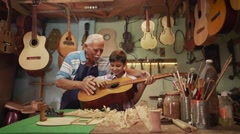 13-Boy Learns Play Guitar With Senior Man Grandpa Stock Footage