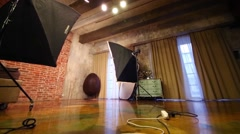 Empty studio with bed, stylish armchair and equipment for shooting Stock Footage
