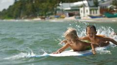 Little children enjoying sea surfboarding on summer vacation Stock Footage