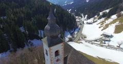 Mountain church, ski resort Dienten Hochkönig, Salzburg, winter, Austrian Alps Stock Footage