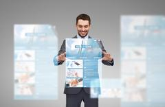 Businessman working with world news projection Stock Photos