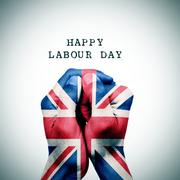 Flag of the United Kingdom and the text happy labour day Stock Photos