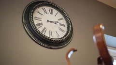Beautiful retro clock with Roman numerals on gray wall - stock footage
