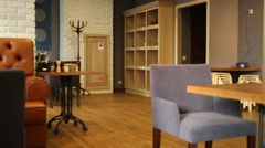 Cozy interior of cafe with wooden tables and leather couches Stock Footage