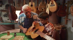 15-Boy Learns Play Guitar With Old Man Grandpa Stock Footage