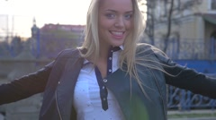 Portrait of a young woman. Urban background. - stock footage