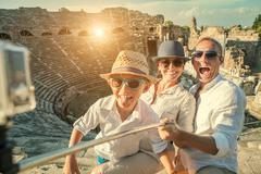 Young positive famly take a vacation photo on the Side ampitheatre view Stock Photos