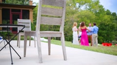 Table and chairs and resting people outdoor at evening Stock Footage