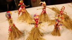 Six straw folklore toy handmade dolls are on table Stock Footage