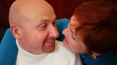Close up of middle-aged couple caress each other indoor Stock Footage