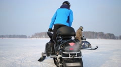 Two men rides on snowmobiles on snowy field at winter Stock Footage