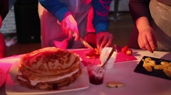 Hands of people cooking cake of pancakes and fruit Stock Footage