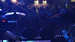 Drum on the stage, nirght club, unrecognizable unfocused peaple. Stock Footage