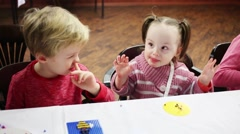 Close up of little cute boy and girl playing mosaic at table Stock Footage