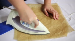 Female hands iron paper for making plastic odd job bee Stock Footage