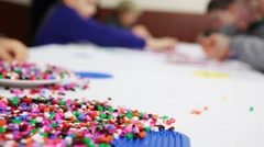 Children hands play bright plastic mosaic at table. Focus on toy Stock Footage