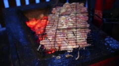 Raw meat in grill for barbecue at winter night. Close up Stock Footage