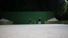 Two girls teenagers friends skate on ice rink and brake Stock Footage