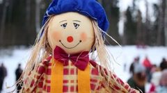 Straw puppet and many people are out of focus in winter Stock Footage