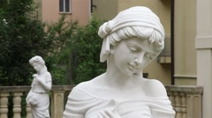 White statue sculpture of young lady outdoors Stock Footage