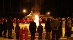 People look at bonfire at night during Shrovetide Stock Footage