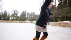 Happy teenager girl graceful skates at rink in winter day Stock Footage