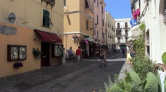 A bicycle crosses the street in a Mediterranean old town - stock footage